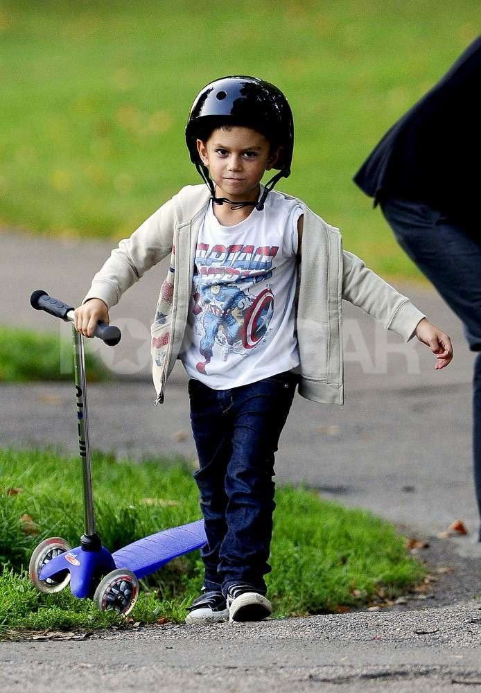 Kingston brought his scooter to a park.
