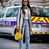 An Animal print Coat, White Blouse, Jeans, and Mustard Accessories