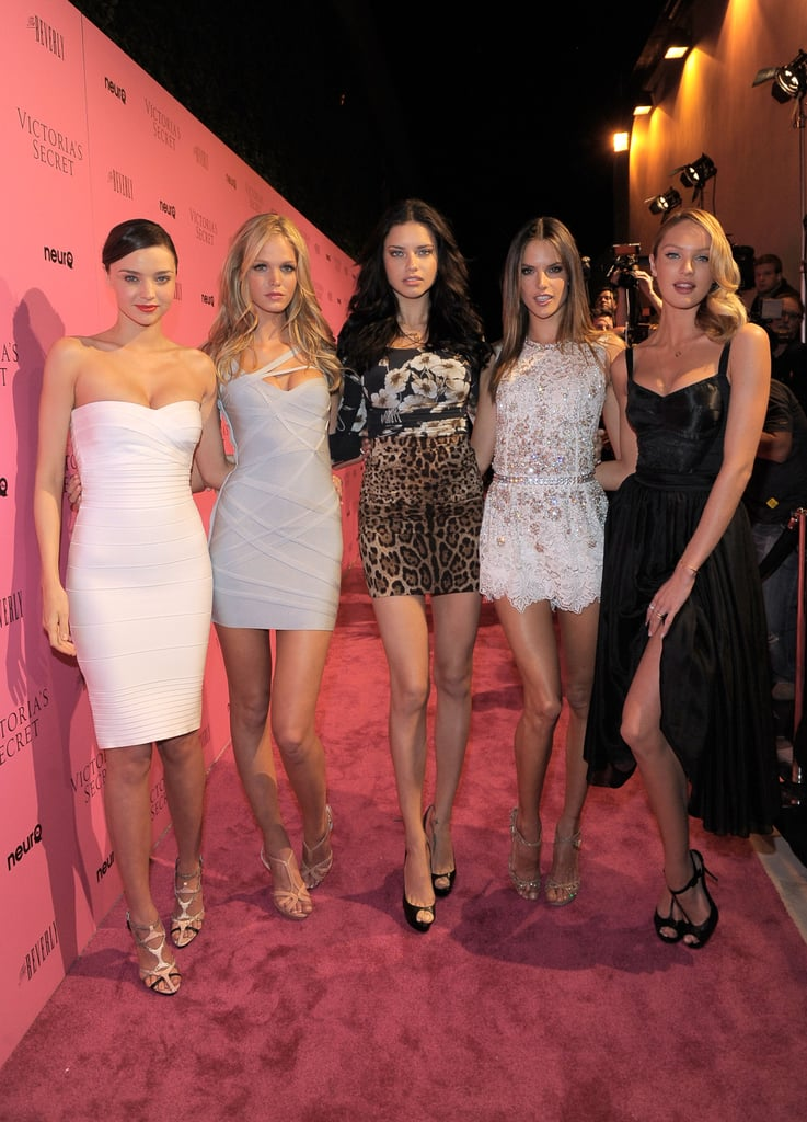Victoria's Secret models Miranda Kerr, Alessandra Ambrosio, and Adriana Lima reconvened in LA for the reveal of the brand's What Is Sexy? list last night. They were joined again by Erin Heatherton and Candice Swanepol after the group of lovely ladies got together for a photo shoot at The Grove earlier in the day. The Angels have been making rounds to promote Victoria's Secret's Bombshell Summer and Miranda hosted her own pool party on Wednesday to kick off the week of press. She shared her thoughts on being a bombshell, but also touched on her experience as a new mom. Miranda, Adriana, and Alessandra all have motherhood in common while keeping up their sexy status as VS Angels. Also on hand were Something Borrowed's Colin Egglesfield, Kellan Lutz, and Paris Hilton.
