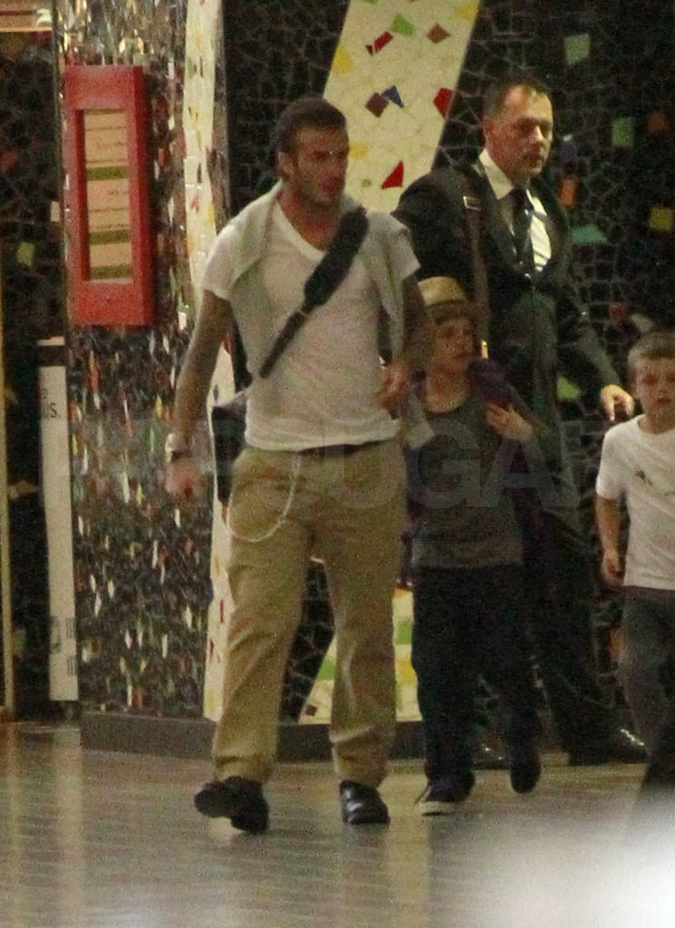 The Beckham family all arrived at LAX yesterday afternoon headed to London for tomorrow's royal wedding! David and Victoria Beckham are among the stars who earned the coveted invite, though they're not the only celebrities with royal wedding fever. Posh and Becks also brought along their three boys Cruz, Brooklyn, and Romeo to take part in the historic event in their home country. With just under 24 hours to go until the big I Dos, crowds are already forming around Westminster Abbey. Prince William and Kate Middleton were spotted at rehearsals, putting the finishing touches on the highly anticipated ceremony. All eyes will be on Kate's dress, of course, but there will also be tons of attention on the fashion of the rest of the attendees. Victoria is an international style icon already, so the pressure is on to look perfectly stylish on the big day. Whether she covers her growing baby bump in something flowy or form fitting she'll have the ultimate accessory on her arm, her handsome husband David.