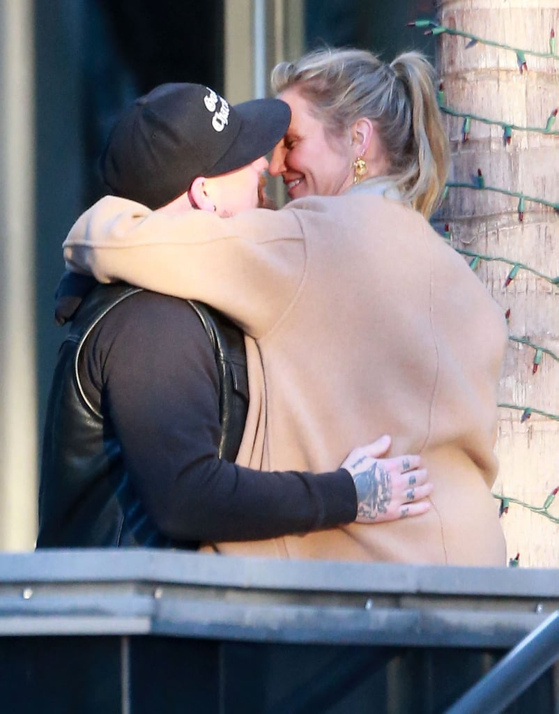 Cameron Diaz and her husband, Benji Madden, parted ways in the sweetest way possible while out in LA on Friday. The couple was spotted at a Century City office building and were all smiles while hugging and stealing a few kisses before they headed in different directions. Benji and Cameron are quickly coming up on their second wedding anniversary — they tied the knot in a surprise ceremony back in January 2015 — and the Good Charlotte singer's twin brother, Joel Madden, recently celebrated his own marriage milestone with wife Nicole Richie; the couple marked six years of wedded bliss just last week.      Related:                                                                A Peek Inside Benji Madden and Cameron Diaz's Sweet Love Story                                                                   There's Something About Cameron Diaz: Look Back at Her Many Loves