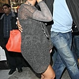 Beyoncé Knowles carried an orange purse.
