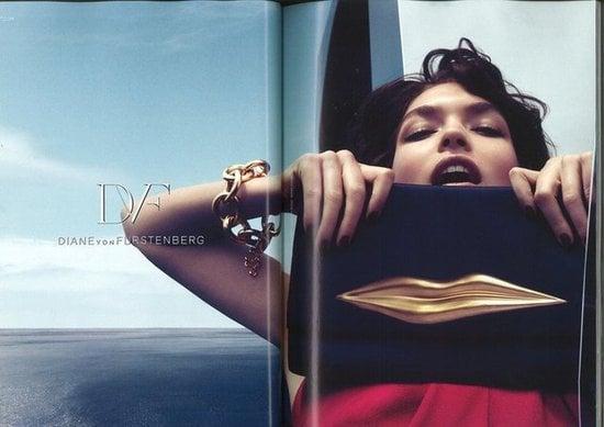 Arizona Muse poses with Diane von Furstenberg's lip-embossed clutch.