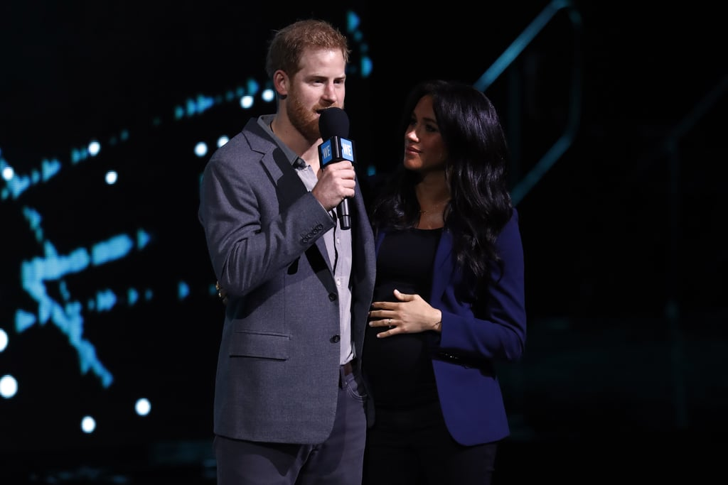 Prince Harry hit the stage in front of 12,000 young people at the WE Day UK event on Wednesday, and he brought a surprise guest onto the stage with him . . . his wife, Meghan Markle. Harry's appearance at the event was known ahead of time, but nobody was expecting Meghan to pop up at his side. The two looked so loved-up as they waved to fans from the stage, and Meghan couldn't keep her eyes off her husband. The prince gave an impassioned speech about climate change at the event, which aims to inspire young people to get involved in social change. The Duchess of Sussex is showing no sign of slowing down as she nears the end of her pregnancy: if anything, she's busier than ever. Following the royal tour of Morocco, the couple had a secret date night at the theatre, and celebrated Prince Charles's investiture with a family reunion at Buckingham Palace. No doubt she'll try and squeeze in a few more royal events before the big move to Frogmore House in Windsor, and the birth of their first child. Until then, take a look at all the photos from their sweet onstage appearance ahead.