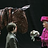 "Queen Elizabeth II attends ""War Horse"" at the National Theatre in 2013."