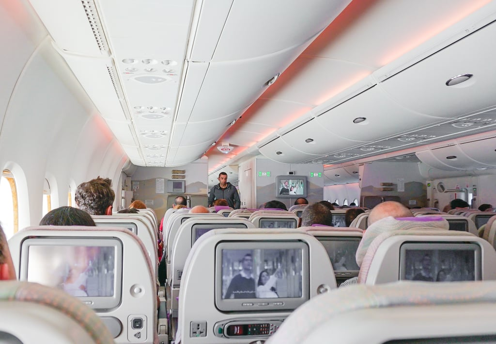Offer your seat on a plane so a family or couple can sit together.