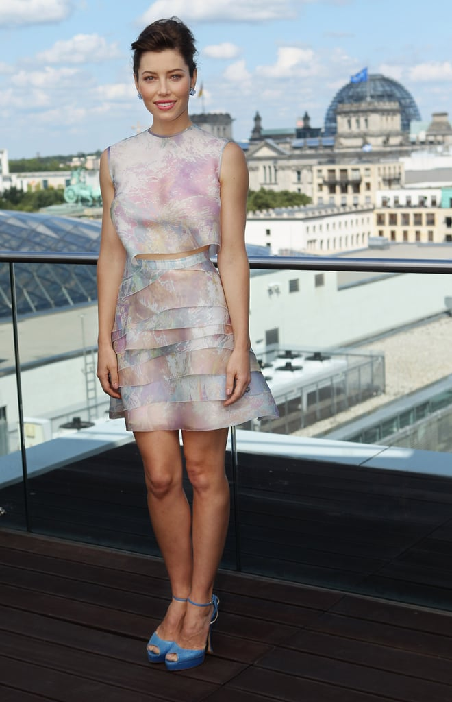 Jessica attended the Total Recall photocall in Berlin wearing a watercolor-printed crop top paired with a tiered skirt, both by Christian Cota, and blue Brian Atwood peep-toe sandals.