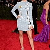 In 2015, Hailey wore a custom Topshop blue minidress to the Met Gala.
