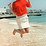 Juliette Binoche jumped for joy on the beach in 1985 — a pose she still loves to do to this day!