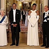 Queen Elizabeth II and Prince Philip stood by a dapper President Obama and First Lady Michelle at a May 2011 State Banquet.
