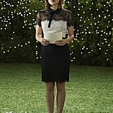 Aria is wedding ready in this lacy black-and-white dress, which she paired with gold shoes.