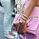 Guess who? Anna Dello Russo matched her Valentino clutch to her Versace mini.