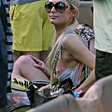 Paris Hilton wore oversized shades and a headband by the pool.