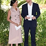 Meghan, Duchess of Sussex Wearing A Beige Sleeveless Belted Trench Dress