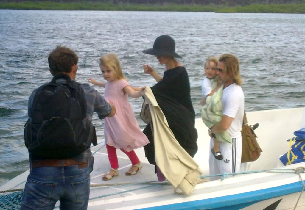 Angelina Jolie and Brad Pitt helped their twins Vivienne and Knox Jolie-Pitt off a boat on their journey home from the Galapagos Islands in April.
