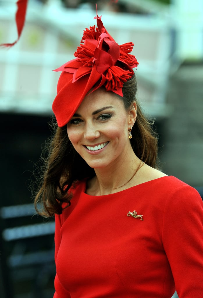 We got a closer glimpse of Kate's polished look — her hat and her brooch.
