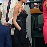 Victoria Beckham made her way into the Wimbledon stands wearing a slip dress.