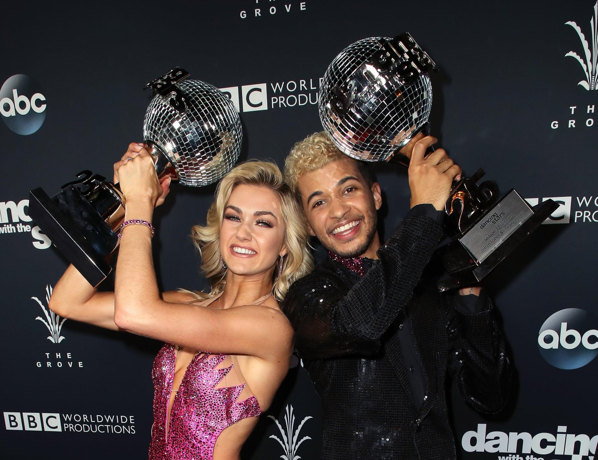 LOS ANGELES, CA - NOVEMBER 21:  Singer Jordan Fisher (R) and dancer Lindsay Arnold pose at