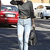 Miley Cyrus wore high-waisted jeans with a Moschino belt to stop at Starbucks.