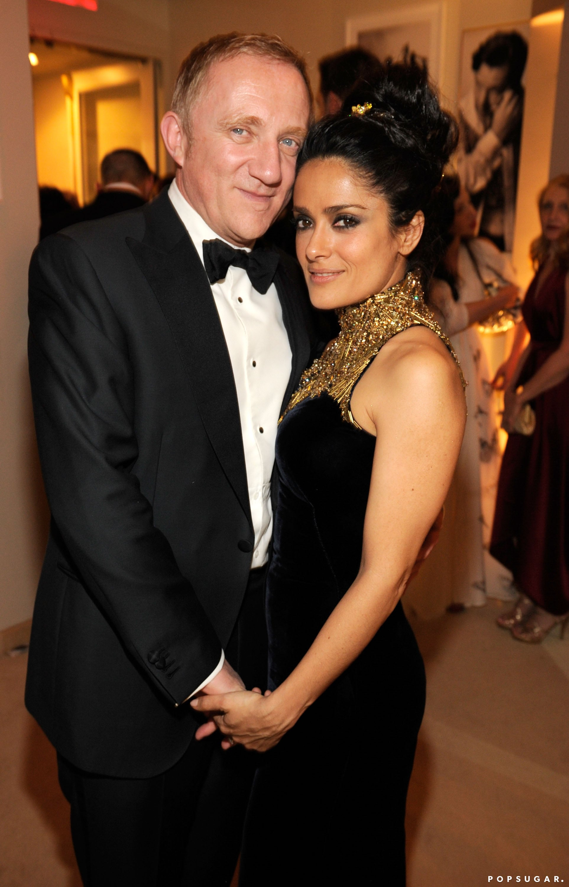 Fracois-Henri Pinault and Salma Hayek cozied up to one another at Vanity Fair's Oscar after-party.