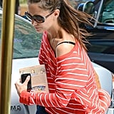 Katie Holmes carried Brave Emily, an American Girls paperback, for her daughter, Suri, while in NYC in June 2012.