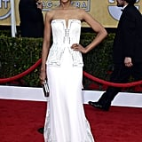 Kerry Washington looked absolutely amazing in a white corseted Rodarte confection with detailed embroidery and lace trim and white Christian Louboutin python pumps.