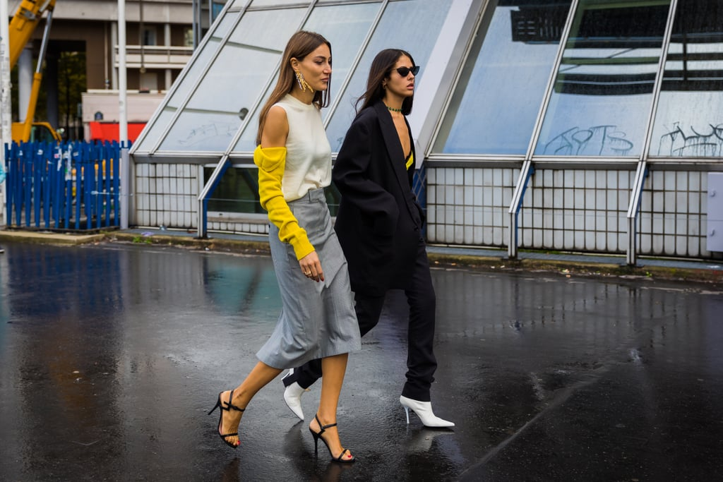 Each of these outfits is comprised of simple enough silhouettes with subtle statement-making pieces, like white heels and a sweater that flashes some skin.