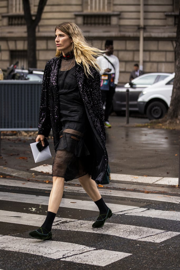 A sheer black dress and sequin jacket geet the post-holiday treatment with the addition of a pair of flats—especially when you style them with retro-looking mid-calf socks for added detail.