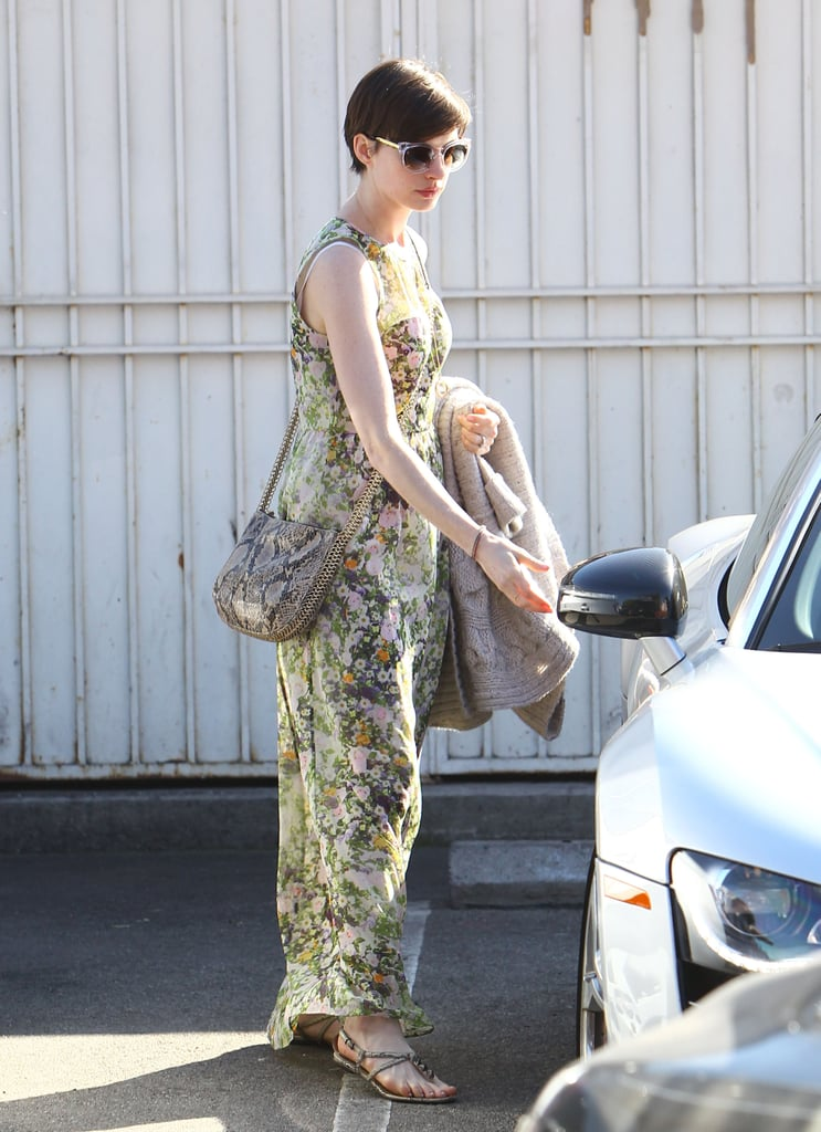 On a sunny day out in LA, python-print Stella McCartney crossbody bag ($1,200), then finished off with flat sandals and clear sunglasses.
