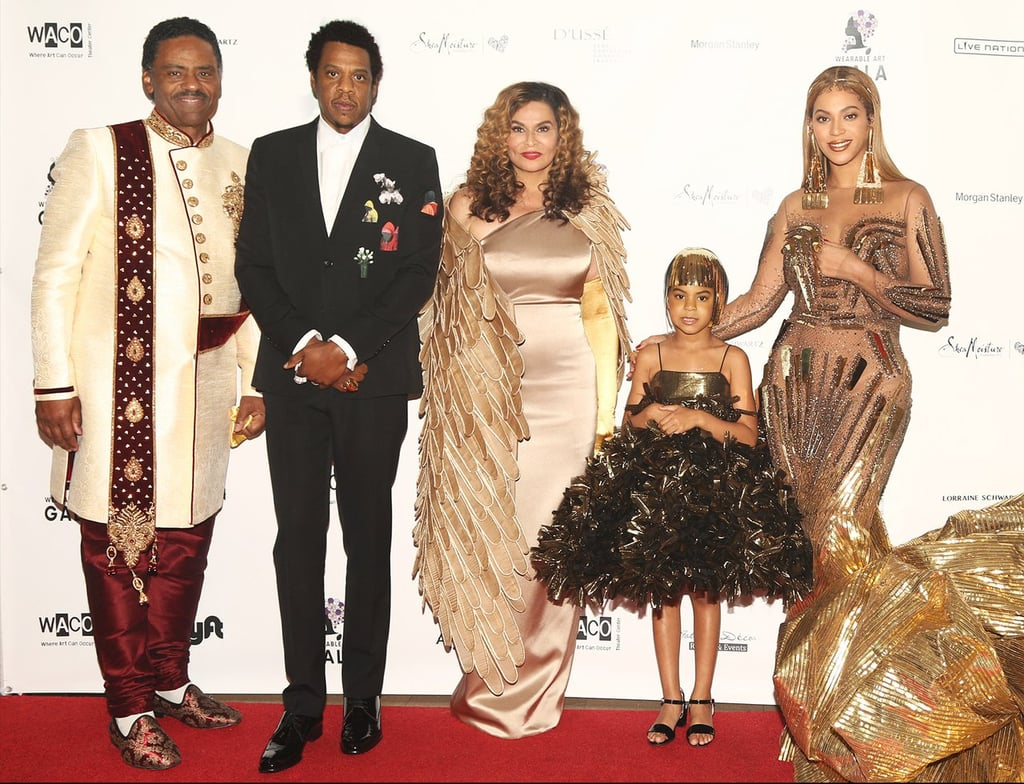 "The second annual Wearable Art Gala was a family affair for the Knowles-Carters. Beyoncé, JAY-Z, and Blue Ivy were in attendance at the WACO Theater in LA on Saturday night, where the Lemonade singer was honored for her humanitarian work. The swanky gala, organized by Bey's mom, Tina Knowles, and her husband, Richard Lawson, was also attended by JAY-Z's mother, Gloria Carter, who was given the Everyday People Award. Gloria also received a touching tribute from the rapper himself. ""She raised four kids, and she did the best job with me,"" he joked. Beyoncé received the 2018 WACO Theater Humanitarian Award and became visibly emotional while delivering her acceptance speech. Before taking to the podium, the mom of three was greeted by Hannah Brammer, a 17-year-old fan born with brittle bones who has met the singer at concerts before. Bey also got a special shout-out from BFF and former first lady Michelle Obama via a prerecorded message, which was played on screen. The dress code for the evening was ""from WACO to Wakanda,"" inspired by the gorgeous setting in Black Panther, and the event featured an auction of artwork to raise money for a nonprofit art and performance complex. At one point, Blue, who wore a gold wig, completely upstaged her famous parents, bidding $17,000 on an acrylic painting of a young Sidney Poitier. JAY-Z attempted to stop her by taking away her paddle, but it didn't work. Blue bid even higher at $19,000.   Unfortunately, she lost out on the piece to director Tyler Perry for a cool $20,000, Vanity Fair reports. That doesn't mean the adorable 6-year-old left empty-handed, though. Blue bid $10,000 on another piece made of deconstructed law and medical books and took home the prize like the true boss that she is. The moment was too cute to miss and has since gone viral online. Keep reading to see more pictures and videos from the Knowles-Carters' heartwarming night out.      Related:                                                                                                           We Made a Family Scrapbook For Beyoncé and JAY-Z, Because Why Not"