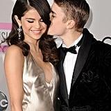 Justin Bieber gave girlfriend Selena Gomez a kiss on the cheek in 2011.