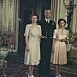 Margaret (somewhat begrudgingly) posed with her sister Elizabeth and her new fiancé, Prince Philip, after their engagement announcement in 1947.
