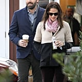 Ben Affleck wore a blue blazer over a gray sweater.