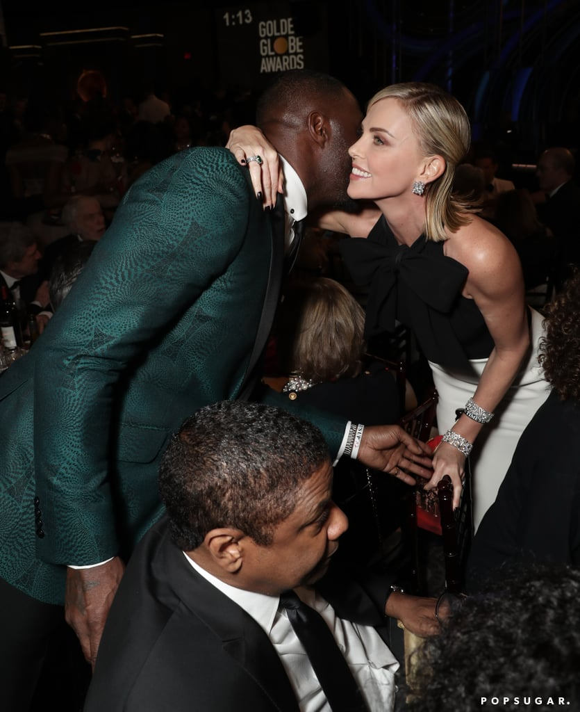 Denzel Washington Being a Dear and Moving Out of the Way So Charlize Theron Can Get a Proper Hug From Idris Elba