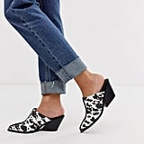 ASOS DESIGN Scarlett western black heeled mules in cow print