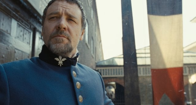 We would love to get our hands on that French banner, but it's Russell Crowe, as the policeman Javet, that really catches our eye.