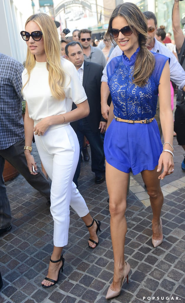 While strolling through The Grove in LA, Alessandra Ambrosio showed off her sexy gams in this Lover cobalt lace romper ($649) and nude pointy pumps.