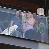 Britney Spears was happy to wave to fans from her balcony in Rio de Janeiro with Jason Trawick.