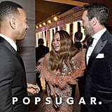 Pictured: John Legend, Chrissy Teigen, and Jon Hamm