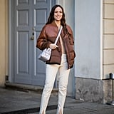 Winter Outfit Idea: A Sleek Puffer, Slit Pants, and White Pumps