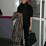 The Australian singer used the quilted kicks to finish off a combo of black pants and top she wore in Paris recently. And while we might be more used to seeing some diva leanings come her way, she kept things just a touch glam with a sparkly scarf and long, furry coat.