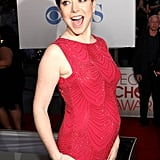 Pregnant Alyson Hannigan in a red dress.