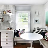 Adding banquet seating and a round tulip table makes it possible to have a breakfast nook in cramped kitchen quarters.