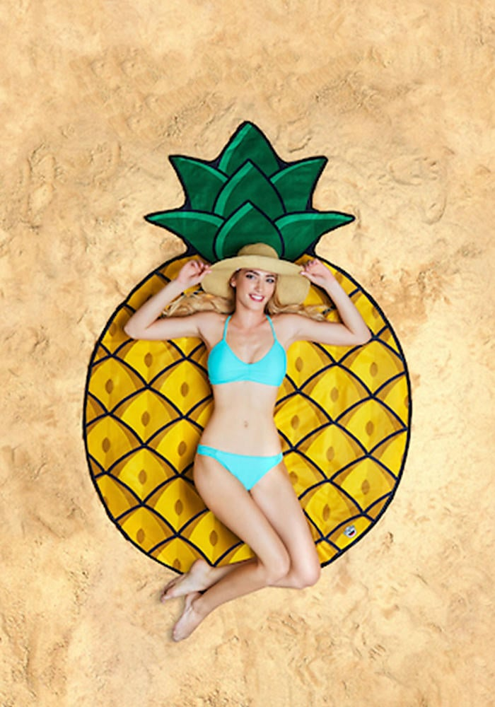 If this blanket isn't Instagram goals, then we don't know what is.Giant Pineapple Beach Blanket ($25)