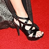 Natalie Morales gets a leg up on the black strappy platform.