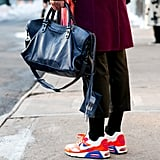 Who knew how well a Balenciaga bag went with Nikes?!
