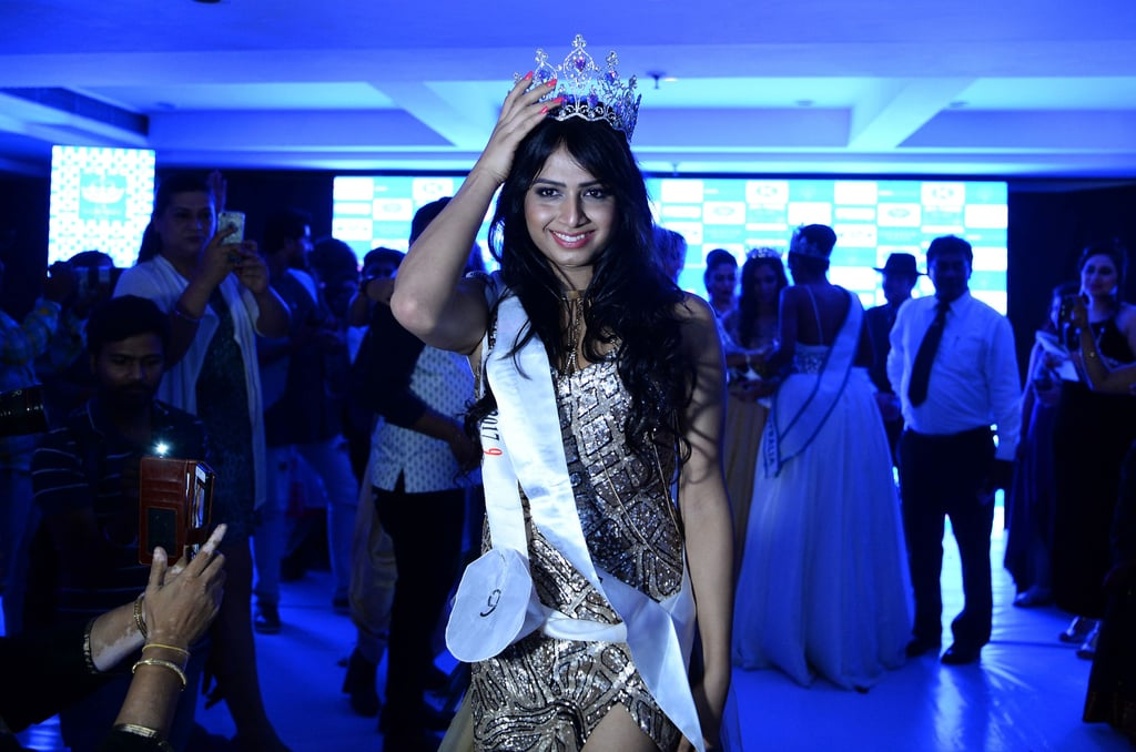 "On Aug. 27 in Gurgaon, India, as Lady Gaga's ""Born This Way"" played over a loudspeaker, a woman named Nitasha Biswas made history. The 26 year-old fashion student has just become the inaugural winner of Miss Transqueen India, the country's first transgender beauty pageant. For the most part, the night carried on like any normal pageant (because it was one!), but its social significance has reinvigorated India's dynamic yet  complex LGBTQ+ community. As CNN noted, the hijra, or trans citizens of India, have played an important role in the country's past 3,000 years. During the 16th century, hijras served as respected government advisers, but the group has also been met with widespread discrimination. (In 2014, the Indian government voted to give hijras the legal right to identify as a third gender).  That's why business owner Reena Rai decided to start Miss Transqueen India and officially dubbed all contestants ""winners."" She almost went broke funding the pageant (Rai told CNN that at her lowest fiscal point, she had only $156 in her bank account). But Rai remained determined, widdling down 1,500 contestants to 16 finalists, who ranged in age from their early 20s to mid-50s. One hopeful was a lawyer, others were students.  Ultimately, Biswas took home the crown and later told  The Indian Express  that, ""My journey was not easy. I feel very privileged to be where I am today and knowing so much of struggles and hardships that I've gone through."" In March 2018, Biswas will go on to represent India at Miss International Transqueen in Thailand. In pictures of the event, you can see the contestants doing their own makeup. Their hair was also on point, with equal representation of glamorous pageant girl curls and regal updos.  Biswas wore a peach lip and her hair down, so we're inclined to think there's something winning about that pairing. We will definitely try to replicate it at our next big event. Read on for stunning pictures from this historical event."