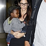 Sandra carried Louis through LAX.