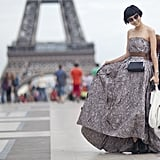 Posing in front of the Eiffel Tower in a floor-length gown is just par for the course at Paris Fashion Week.