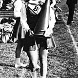 Cheerleader Meryl carried a cone at a game. Source: Seth Poppel/Yearbook Library